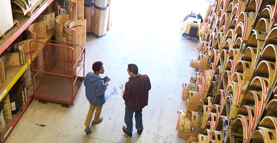 Two men at a warehouse