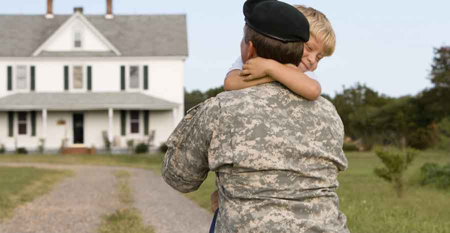 Soldier hugging son